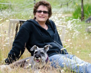 Karla Fisher on farm with her dog